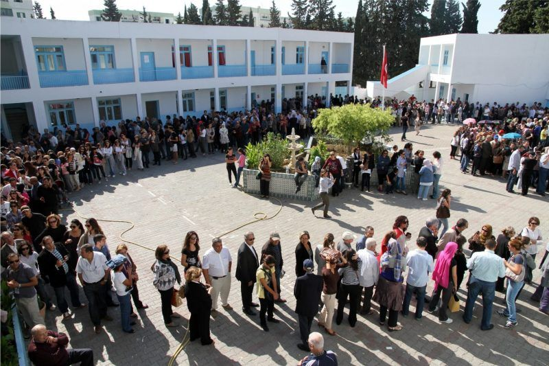 Tunisians voters line up at a polling station in Menzeh, near Tunis, in 2011. (Amine Landoulsi/Associated Press)
