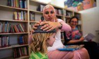 Teacher Alia Tunisi with a student at the Hand in Hand Arab Jewish bilingual school in Jerusalem. Photograph: Ronen Zvulun /Reuters