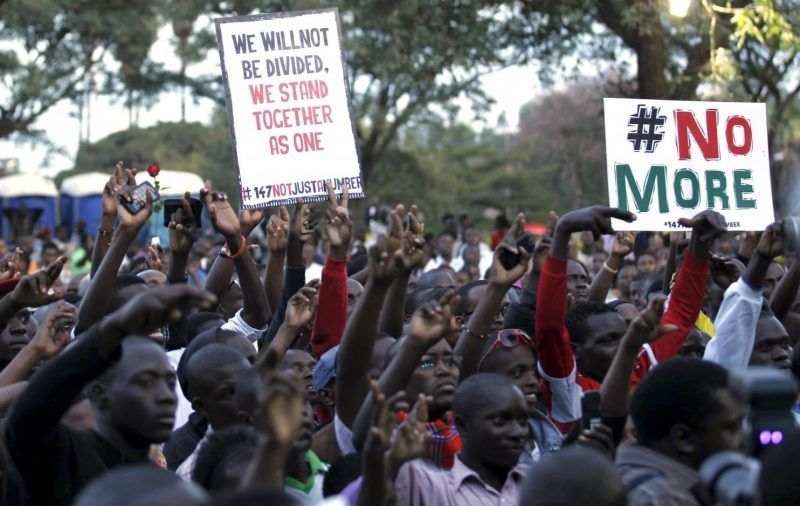 """People carry placards as they attend a memorial concert for the Garissa university students who were killed during an attack by gunmen, at the """"Freedom Corner"""" in Kenya's capital Nairobi April 14, 2015. (Thomas Mukoya/Reuters)"""