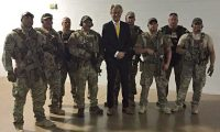 Geert Wilders, the far-right Dutch politician, poses with police officers who responded to the shooting at Muhammad Art Exhibit in Dallas. Photograph: AP