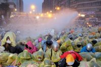 Police use a water cannon to disperse demonstrators protesting the construction of a fourth nuclear plant, in front of Taipei Railway station in Taipei April 28, 2014. (Stringer/Taiwan/Reuters)