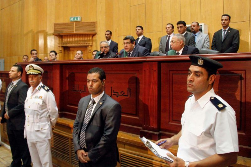 Egyptian Judge Shaaban el-Shami, center, sentences ousted Egyptian President Mohammed Morsi to death. (Ravy Shaker/Associated Press)