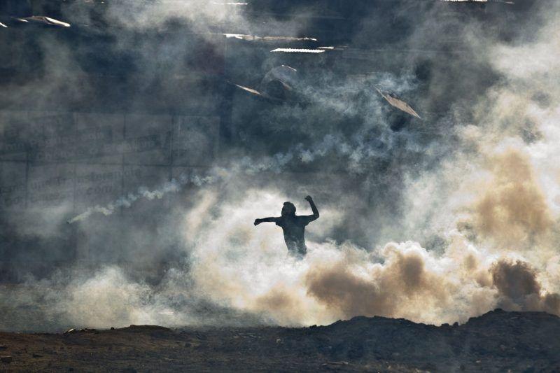A demonstrater near Plaza Altamira in Caracas, Venezuela. (Esteban Felix/Associated Press)