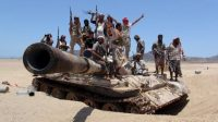 Anti-Houthi fighters of the Southern Popular Resistance stand on a tank in Yemen's southern port city of Aden, May 10, 2015. REUTERS/Stringer