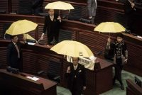 Pro-democracy lawmakers in Hong Kong stage a walkout before an address by Chief Executive Leung Chun-ying in January. Credit Philippe Lopez/Agence France-Presse — Getty Images