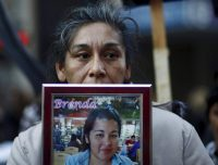 Teresa Ponce displays a photo of her daughter at a protest in Buenos Aires on June 3. There have been 1,808 femicides since 2008. Credit Marcos Brindicci/Reuters