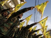 Lebanon's Hezbollah members carry Hezbollah flags during the funeral of their fellow fighter Adnan Siblini, who was killed while fighting against insurgents in the Qalamoun region, in al-Ghaziyeh village, southern Lebanon May 26, 2015.
