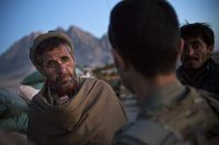 A member of the Afghan local police meets with soldiers from the U.S. Army in Kandahar Province, Afghanistan, January 20, 2013. REUTERS/Andrew Burton