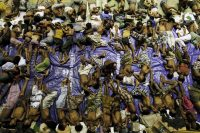 Migrants believed to be Rohingya rest inside a shelter after being rescued from boats at Lhoksukon in Indonesia's Aceh Province May 11, 2015. REUTERS/Roni Bintang