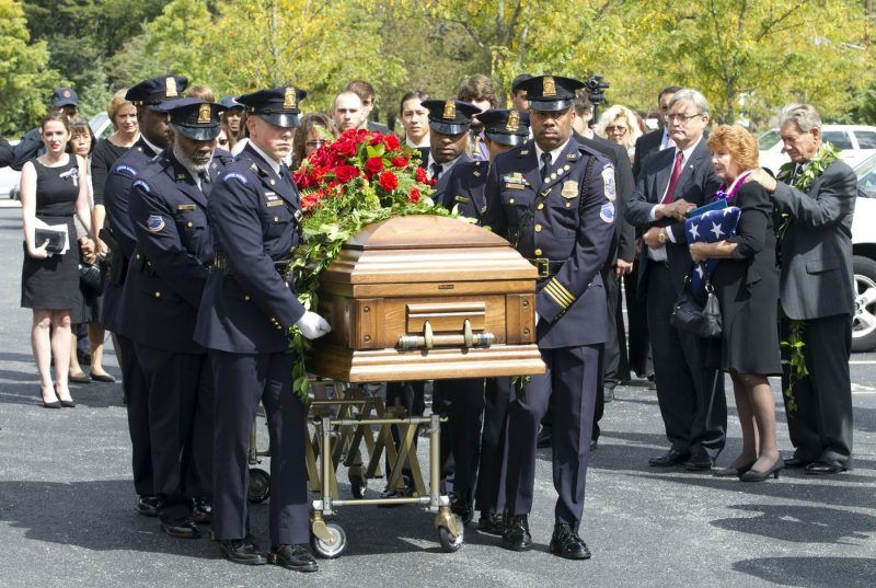 Police officers carry the coffin of Richard Michael Ridgell, 52, of Westminster, Md. after his funeral service on Sept. 28, 2013. Ridgell was one of the 12 victims who died in the Sept. 16, 2013 Washington Navy Yard shootings. (Jose Luis Magana / Associated Press)