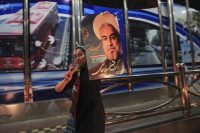 A supporter of moderate cleric Hassan Rouhani celebrates his victory in Iran's presidential election along a street in Tehran June 16, 2013. REUTERS/Yalda Moayeri