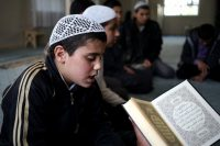 A Syrian boy in April recites verses from the Quran at a teaching center designed to counter Islamic State indoctrination. (Hussein Malla/Associated Press)
