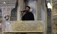 A man purported to be the reclusive leader of the militant Islamic State Abu Bakr al-Baghdadi has made what would be his first public appearance at a mosque in the centre of Iraq's second city, Mosul, according to a video recording posted on the Internet on July 5, 2014. REUTERS/Social Media Website via Reuters TV