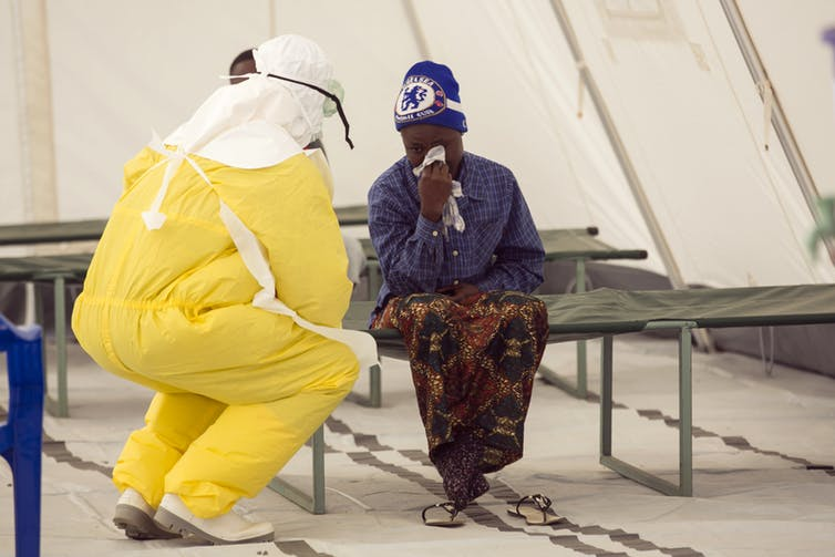 A health worker and Ebola patient in Koidu, Kono district in December. Reuters/Baz Ratner