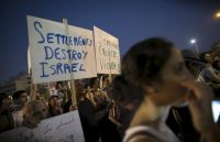 Protesters at Rabin square in Tel Aviv. Credit Baz Ratner/Reuters