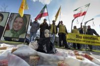 People protest against executions and human rights violations in Iran on a square near the Nuclear Security Summit in The Hague, March 25, 2014. REUTERS/Cris Toala Olivares