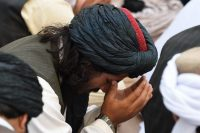 Pakistan members of the Jamiat Nazriati party pray for Afghanistan's Taliban chief Mohammad Omar at a gathering in Quetta on August 1. (Banaras Khan/AFP via Getty Images)