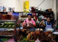 Food vendors in Bangkok. Real G.D.P. growth in Thailand slowed to 2.8 percent year-on-year in the second quarter of 2015, down from 3.0 percent in the first quarter. Credit Rungroj Yongrit/European Pressphoto Agency.