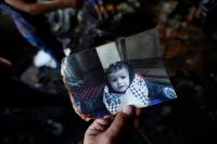 A photograph of Ali Dawabsheh, the Palestinian toddler killed in an arson attack on his home in the West Bank village of Duma in July. Credit Alaa Badarneh/European Pressphoto Agency