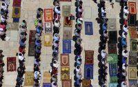 Palestinian men pray on the third Friday of Ramadan at the compound known to Muslims as the Noble Sanctuary and to Jews as Temple Mount, in Jerusalem's Old City, July 3, 2015. REUTERS/Ammar Awad