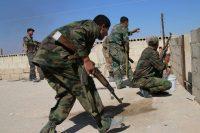 Syrian Army soldiers in Hama, Syria, on Sunday. Credit Alexander Kots/Komsomolskaya Pravda, via Associated Press
