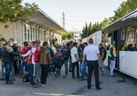 New migrants arrive at a refugee camp located in the Austrian city of Salzburg, near the German border, on Oct. 2. (Guenter Schiffmann / AFP/Getty Images)