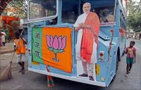 A cutout of Narendra Modi adorning a bus at his party's headquarters in Mumbai. Credit Divyakant Solanki/European Pressphoto Agency