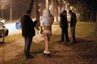 Des policiers contrôlant une prostituée et un client au Bois de Boulogne, en mars 2012. Photo Thomas Samson. AFP