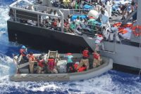 MEDITERRANEAN SEA (Oct. 17, 2013) Distressed persons are transferred from the amphibious transport dock ship USS San Antonio (LPD 17) to Armed Forces of Malta offshore patrol vessel P52 (U.S. Navy photo/Released)
