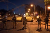 Egyptian soldiers stand guard near the presidential palace in Cairo in July 2013. At the time, thousands of protesters were holding rallies across Egypt to demand the reinstatement of ousted President Mohammed Morsi. (Khalil Hamra/Associated Press)