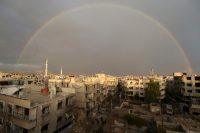 A rainbow is seen as residents inspect damage from what activists said was an airstrike by forces loyal to Syria's President Bashar al-Assad on the main field hospital in the town of Douma, near Damascus, October 29, 2015. REUTERS/Bassam Khabieh