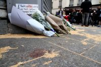A makeshift memorial at the scene of one of the November 2015 Paris attacks/Wikipedia Commons