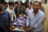 Injured publisher Ahmed Rahim Tutul is carried on a stretcher in Dhaka, Bangladesh, last Saturday. (A.M. Ahad/ASSOCIATED PRESS)