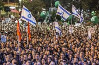 People attend a commemorative rally in memory of late Israeli prime minister Yitzhak Rabin at Rabin Square in Tel Aviv on Oct. 31. (Jack Guez/Agence France-Presse via Getty Images)