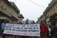 Demonstrators protest Syria's President Bashar al-Assad in Kafranbel in 2012. (HANDOUT/REUTERS)