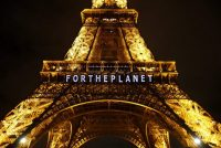 """The slogan """"For the Planet"""" was projected on the Eiffel Tower on Friday as part of the COP 21, the climate conference in Paris. Credit Francois Mori/Associated Press"""