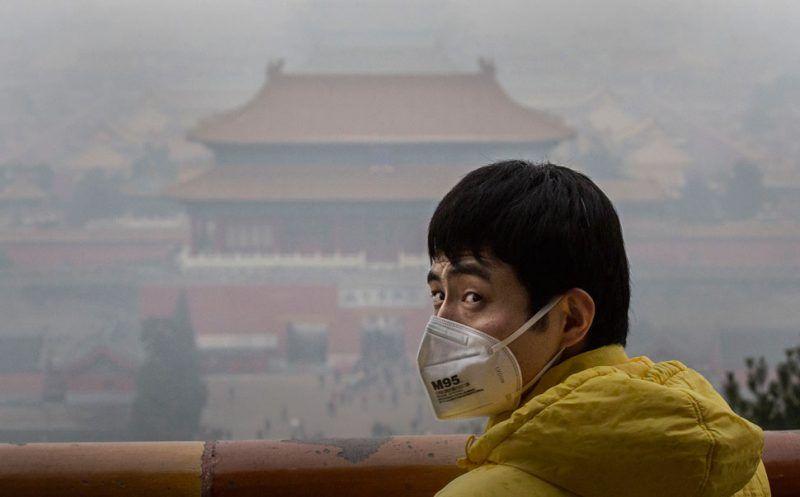A man in Jingshan Park, overlooking the Forbidden City, Beijing, China, December 8, 2015