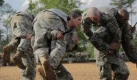 Then-U.S. Army 1st Lt. Kirsten Griest, center, and fellow soldiers participate in combatives training during the Ranger Course on Fort Benning, Ga., in April. (Spc. Nikayla Shodeen/U.S. Army/Reuters)