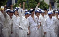 Workers at a supply factory to Honda Motor's joint-ventures in China strike to demand for higher wages, in Guangdong province on June 7, 2010. (Associated Press)