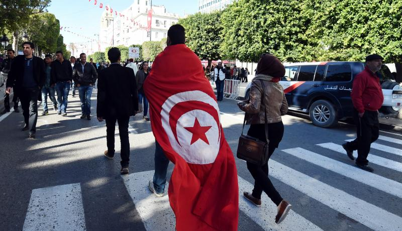 A rally on 14 January 2016 in Tunis marks the fifth anniversary of Tunisia's 2011 revolution. Photo by Getty Images.