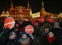 "Supporters of Russian opposition leader Alexei Navalny hold signs saying ""Navalny"" at a rally in Moscow last December protesting a court verdict against the anti-corruption blogger. Navalny received a suspended sentence for embezzling money, but his brother was jailed in a case seen as part of a campaign to stifle dissent. (Tatyana Makeyeva/Reuters)"