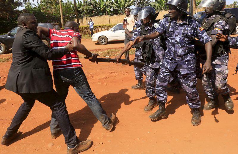 Riot police dispersing a gathering of opposition supporters in Jinja, eastern Uganda, September 10, 2015. James Akena/Reuters/Corbis.