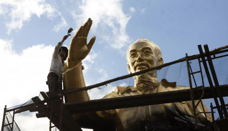A worker repaints a statue of late president Ho Chi Minh at a public park in the southern city of Can Tho, Vietnam. Photo by Getty Images.