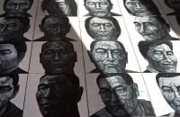 Portraits by Liu Yi of Tibetans who have self-immolated, in his studio, Beijing, December 25, 2012. Andy Wong/AP Images