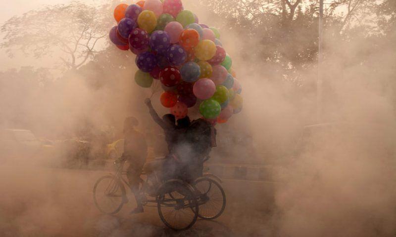 A rickshaw puller on a polluted a street in Dhaka, Bangladesh. Photograph: Zakir Hossain Chowdhury/Barcro
