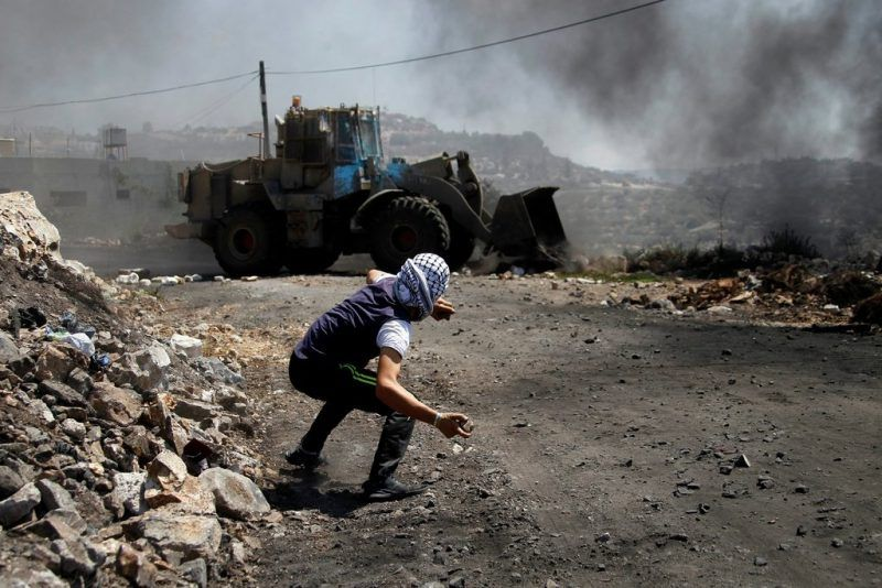 A Palestinian man protesting Israeli settlements in the West Bank. Credit Alaa Badarneh/European Pressphoto Agency