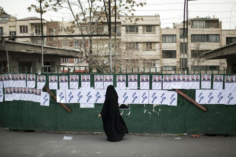 Des affiches du candidat au Parlement Kazem Jalali, à Téhéran, le 22 février. Photo Behrous Mehri