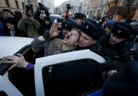 Police officers detain an activist who was taking part in a rally of foreign currency mortgage holders, near the Central Bank headquarters, Moscow, Russia, February 8, 2016. Sergei Karpukhin TPX Images of the Day/Reuters