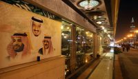 Portraits of King Salman, Crown Prince Muhammad Bin Nayef and Deputy Crown Prince Mohammad Bin Salman on the wall of a restaurant on 7 December 2015 in Riyadh. Photo by Getty Images.