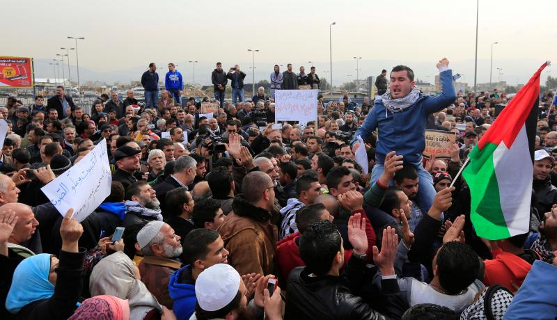 Palestinian refugees protest UNRWA's decision to reduce healthcare support to refugees in Beirut on 22 January 2016. Photo by Getty Images.